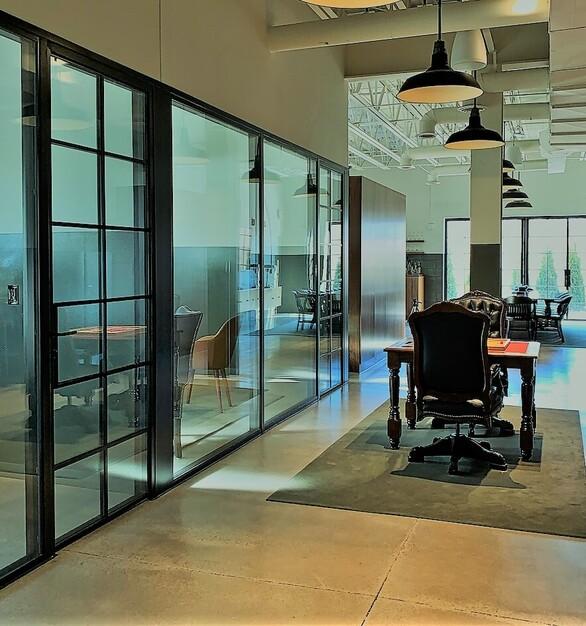 Lobby encompassed by beautiful, thin-framed 2Fold Fixed Windows & Swing Doors
