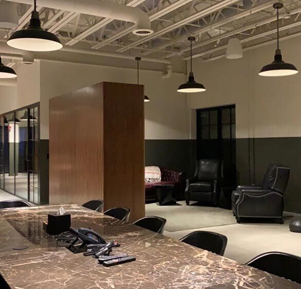 Commercial space outfitted with interior Window Walls for office enclosures and exterior French doors.