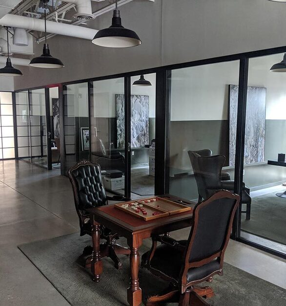 Backgammon table set up in front of a row of offices outfit with 2Fold fixed window units and In-swing doors with muntin grids and lockboxes