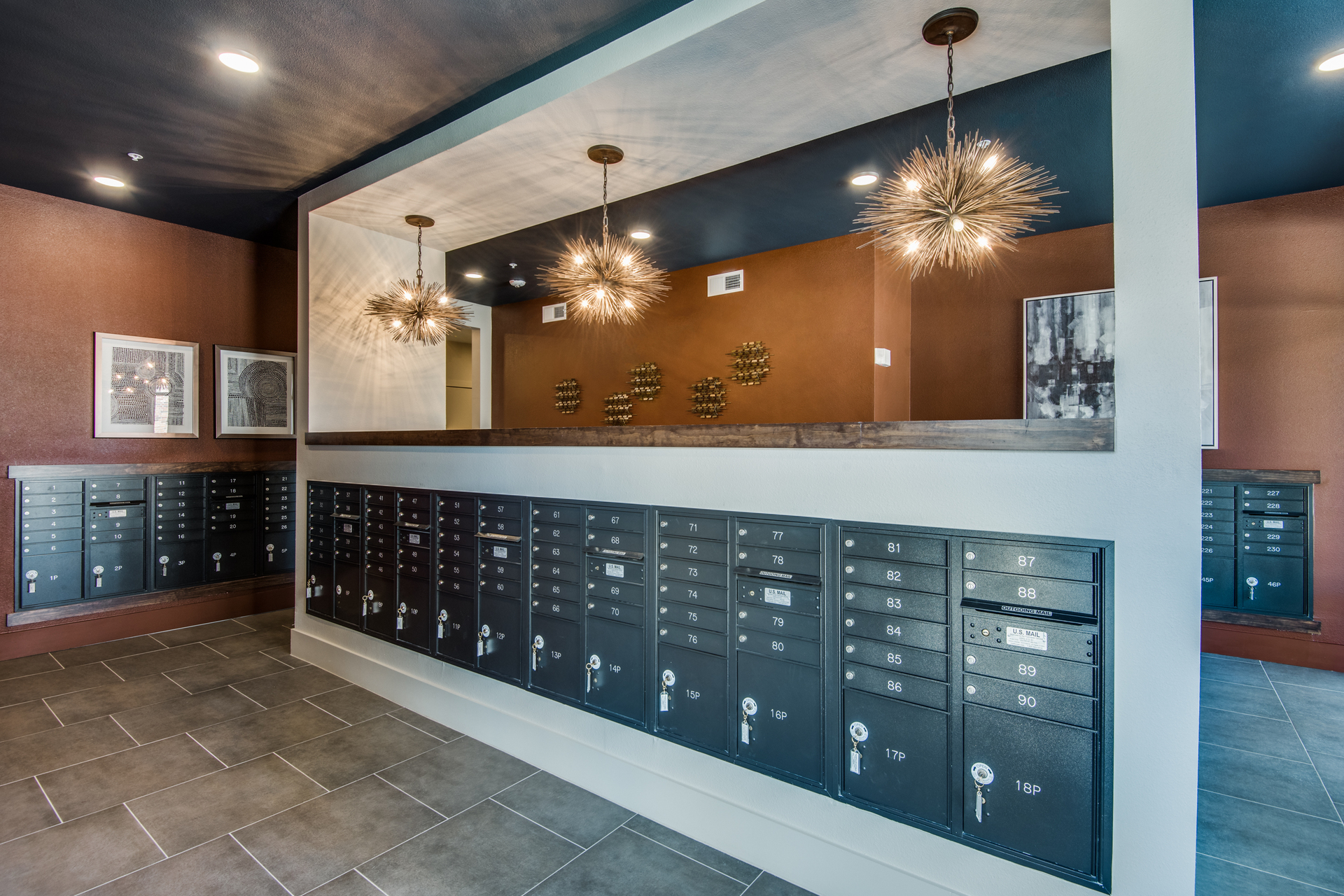 Beautiful mail center with stunning light fixtures for the residents at Hillstone River Walk, by Hensley Lamkin Rachel, Inc.