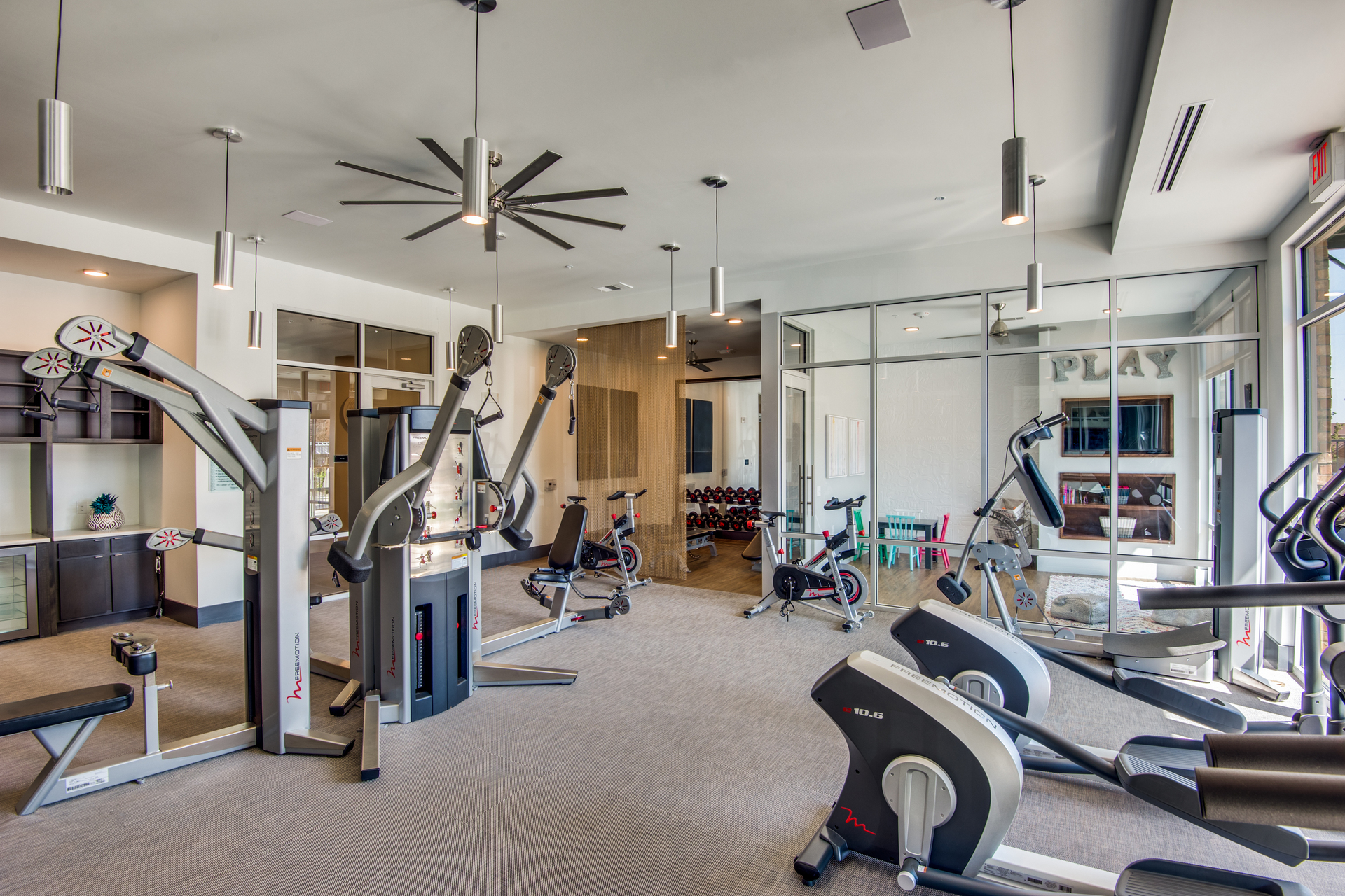 Fitness center including an area for the kids to play while you work out.