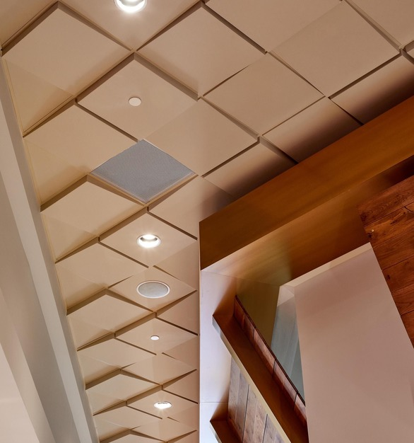Close up view of Above View's Square Drop 1 & 3 Ceiling Tiles along with their Smooth Filler Ceiling Tile featured in the Hard Rock Fire Mountain Harvest Buffet.