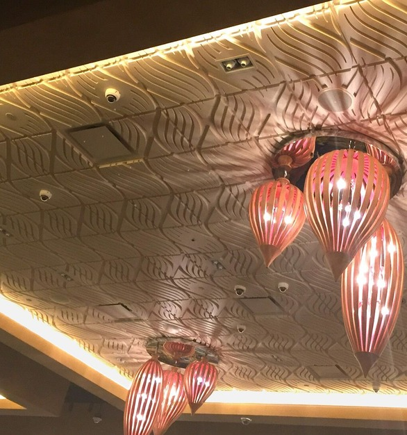 Above View's Wave ceiling tiles are brought to life with dramatic lighting at the Ilani Casino Resort in Ridgefield, Washington.