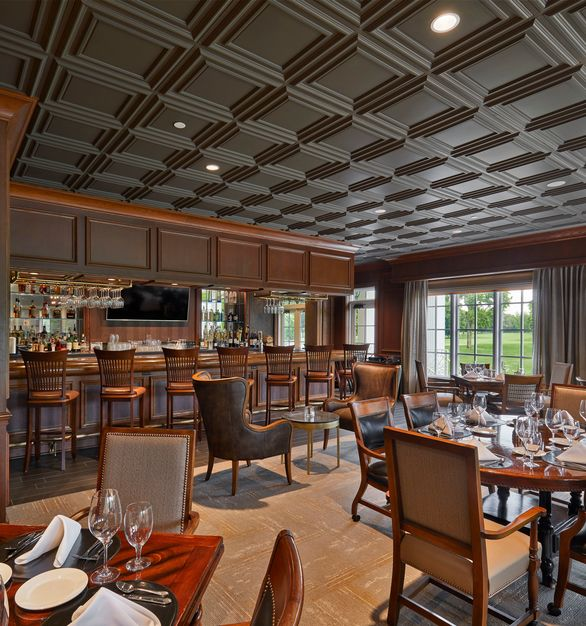 Above View's Classic Panel Ceiling Tile in a Dark Grey finish is featured in the Boyge Bar at the Meridian Hills Country Club.