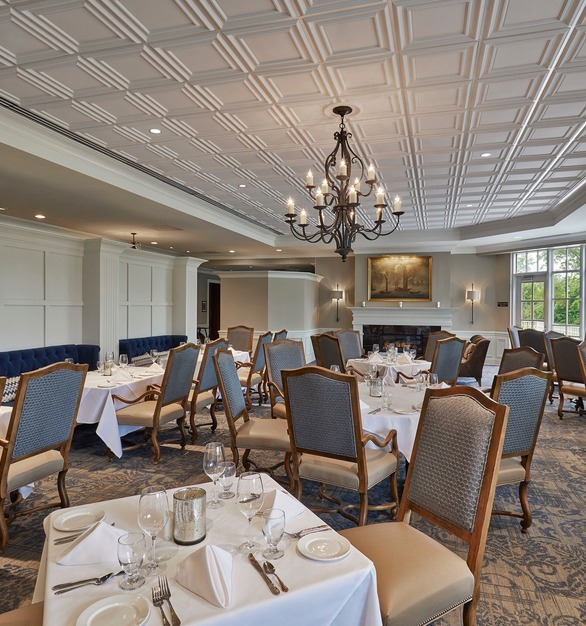 The Hearth Room at the Meridian Hills Country club features Above View's sophisticated Classic Ceiling Tile in a clean white finish.