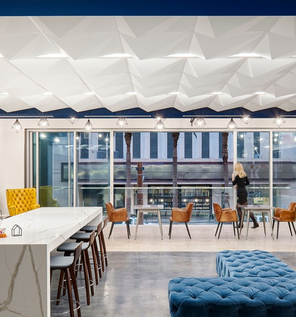 Above View's Pyramid 4 Ceiling Tiles were specified by Gensler to create the dramatic ceiling in the hub of the Monrow Amenities Office.