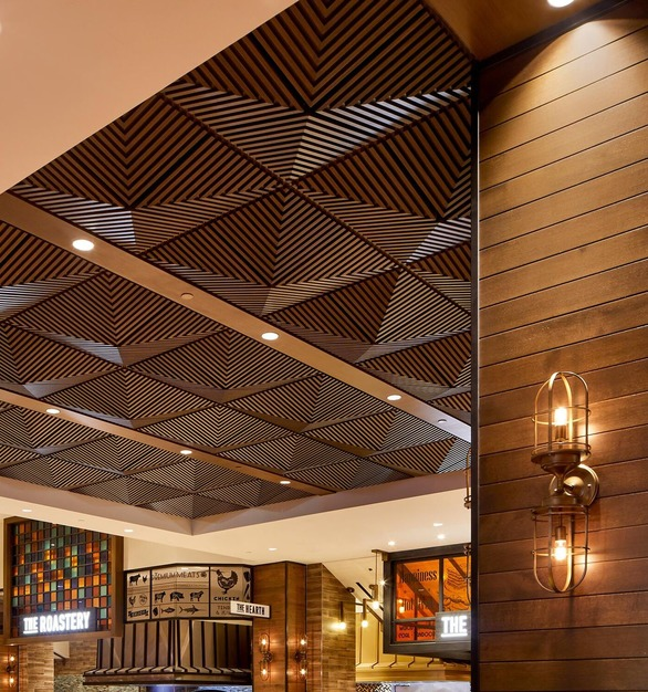 "Palms Casino Resort in Las Vegas, Nevada, features Above View Inc's Grooved Quarter Pyramid Ceiling Tile in a custom faux wood grain finish, ""rift cut white oak""."