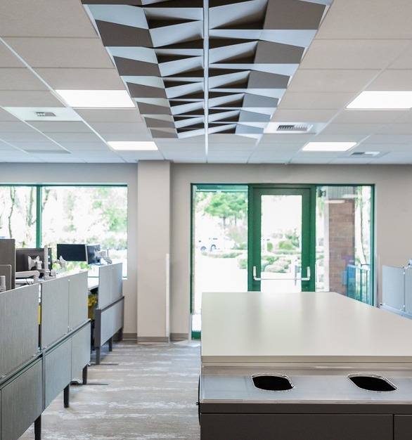 The Twin Star Credit Union features Above View Inc's Quad Wedge Ceiling Tile (TL-0062) in a striking custom satin gray color.