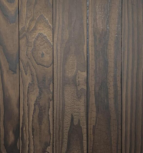 Shou Sugi Ban ACCOYA Undressed by Pioneer Millworks. Charred wood siding and paneling that is burned, brushed once, and left unfinished.
