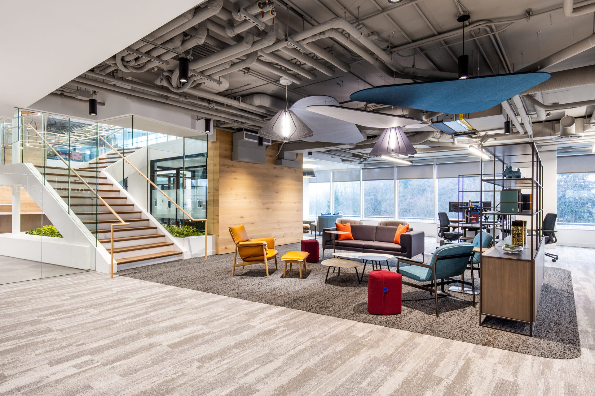 Fully enclosed to minimize accumulation of dust and debris, the Kwyet Acoustic Pendant hanging lights are designed for function and style and fit perfectly in this open office space.