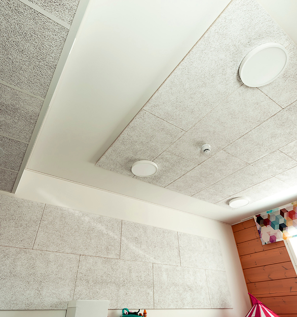 Envirocoustic™ Wood Wool by Acoustical Surfaces can be applied to any space, shown here on the ceiling and walls with a blended color.