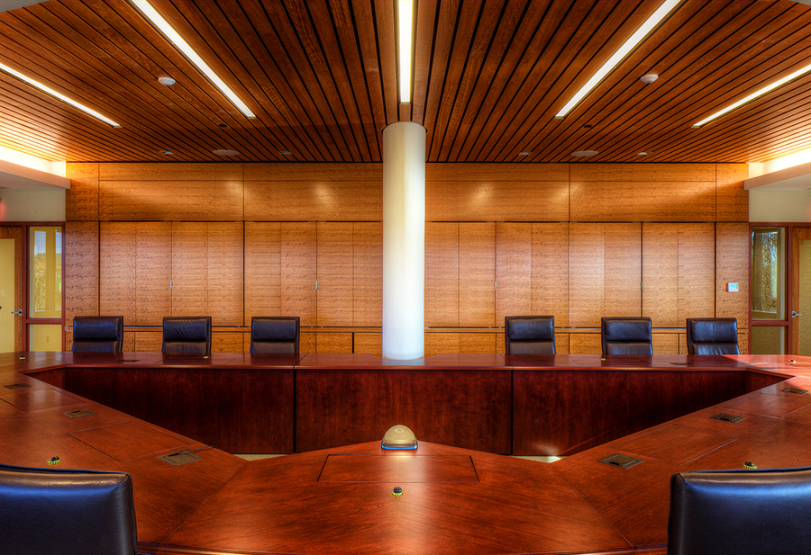 A boardroom with Linwood ceiling by Acoustical Surfaces, based in Chaska, Minnesota.