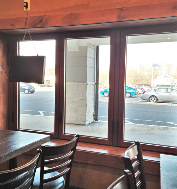Horizontal folding windows to open this indoor dining space to the outside.