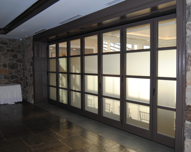 The customization of ActivWall's horizontal folding walls are to include any type of glass panes needed for any space.