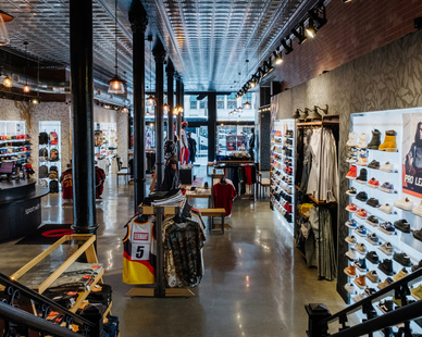 Adamick Architecture collaborated with Athlete's Foot to create a customized, New Orleans-themed store.