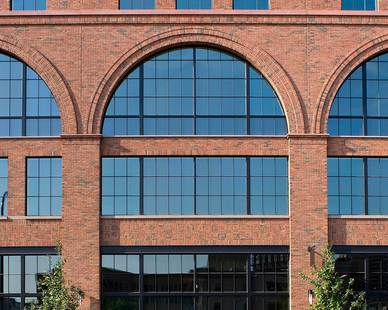 The four-story Millwright building is new construction, but historic-looking exterior features Advanced Formliners embedded brick system.