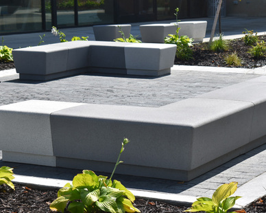 Wausau Tile's Our Town helped create a space with a flexible design component for an already finished space. The smooth, rounded surface of Our Town benches with acid wash finish and a combination of colors provides a fabric friendly surface. The long term low maintenance of precast and sheer weight of concrete was sure to keep each piece in place and always ready to use. The modular design of the Our Town collection allowed for pod space designed for