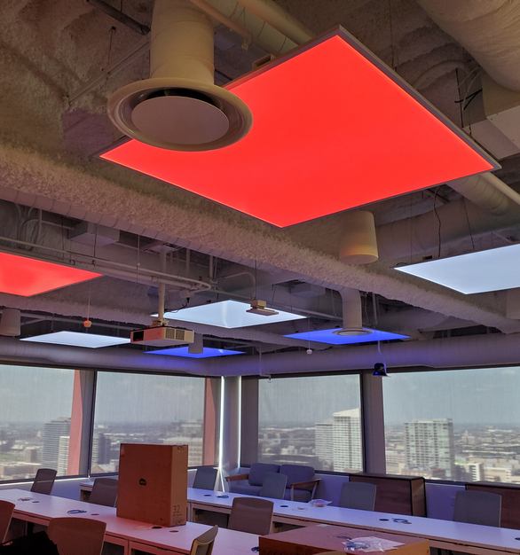 To create an ever-changing sky feeling in the office space, the designer uses the custom square RGBW lighting panels as the ceiling light.
