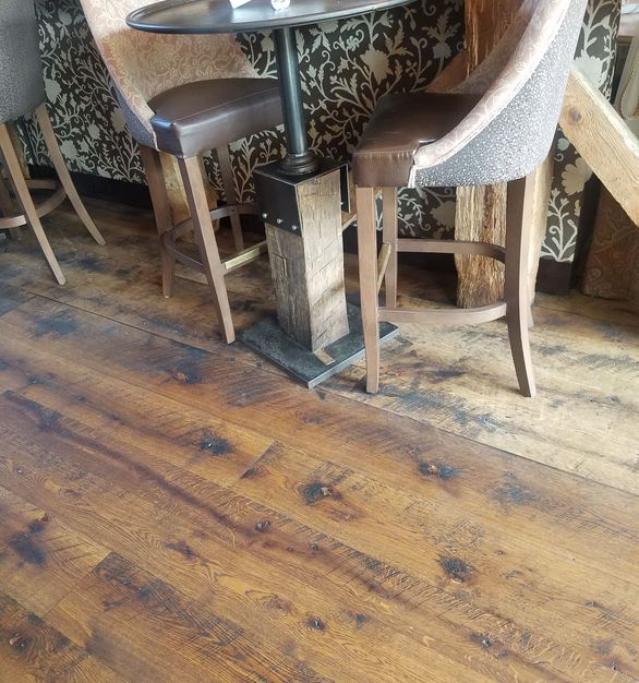 Beautiful live sawn white oak hardwood flooring with circle sawn marks at the Happy Valley Brewery in State College, Pennsylvania, by Allegheny Mountain Hardwood Flooring.