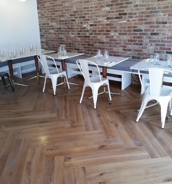 The Vandal used White Oak Live Sawn wood planks by Allegheny Mountain Hardwood Flooring for their stunning double Herringbone flooring.