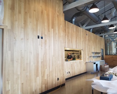 """The Mindful Brewery in Pittsburgh, Pennsylvania, used 4"""" White Oak RQ Select Grade by Allegheny Mountain Hardwood Flooring for their expansive feature wall."""