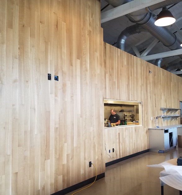 "The Mindful Brewery in Pittsburgh, Pennsylvania, used 4"" White Oak RQ Select Grade by Allegheny Mountain Hardwood Flooring for their expansive feature wall."