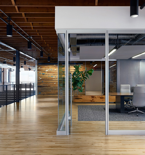 Create an open space environment while using Allteel's Beyond frameless glass walls.