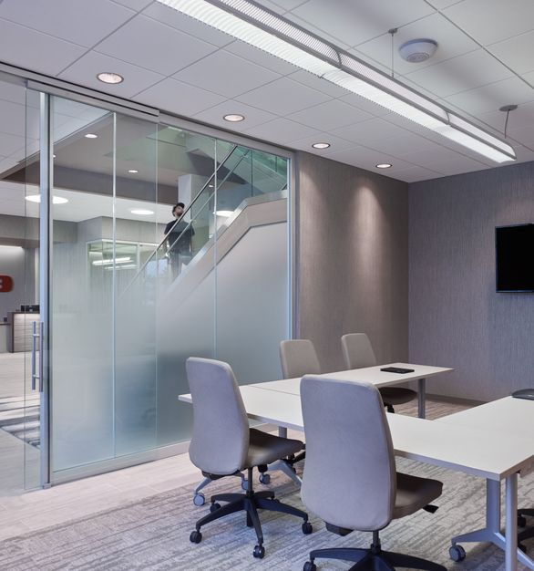 Glass-walled meeting rooms help promote collaboration and innovation between team members, by Allsteel.