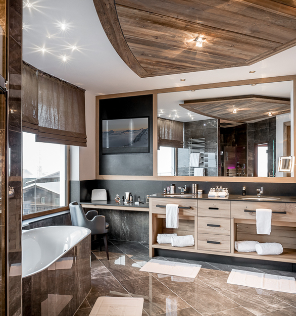 One of the of beautifully designed bathrooms in the penthouse at Alpen - Wellness Resort Hochfirst