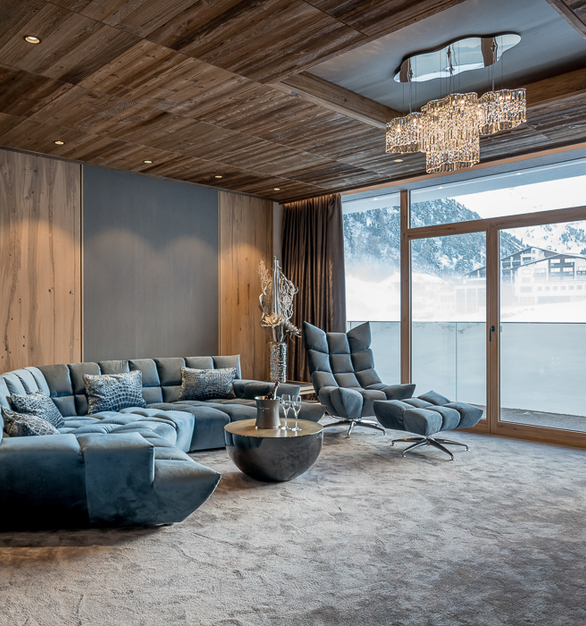 Formal living room with beautiful crystal lighting as the main focus in Alpen - Wellness Resort Hochfirst