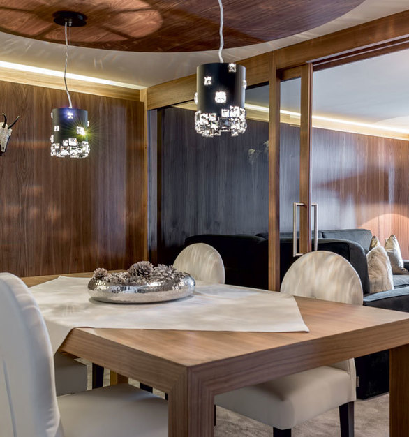 Beautiful crystal lighting above the dining room in the penthouse at Alpen - Wellness Resort Hochfirst