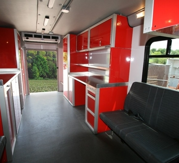 A fire rescue vehicle with Moduline's aluminum cabinets and countertop. Custom Cabinets to make the perfect workstation in any location.