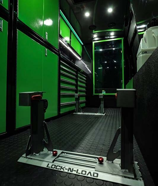 Monster branded Kawasaki motovan with green and black Moduline aluminum cabinets.  Moduline has cabinets to fit any space.