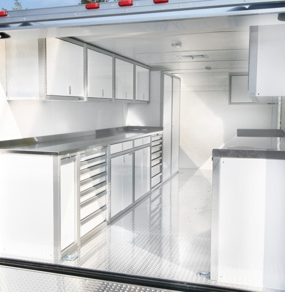 Moduline Lightweight Aluminum Cabinets seen in a trailer is perfect way to have a traveling workspace.