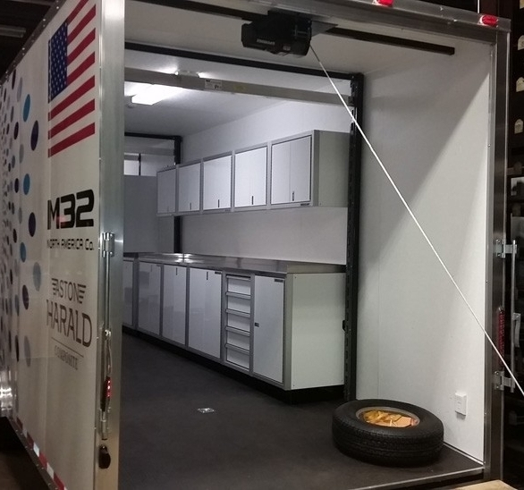 Be the envy of your racing buddies--this racing trailer showcases Moduline's Aluminum Cabinets.