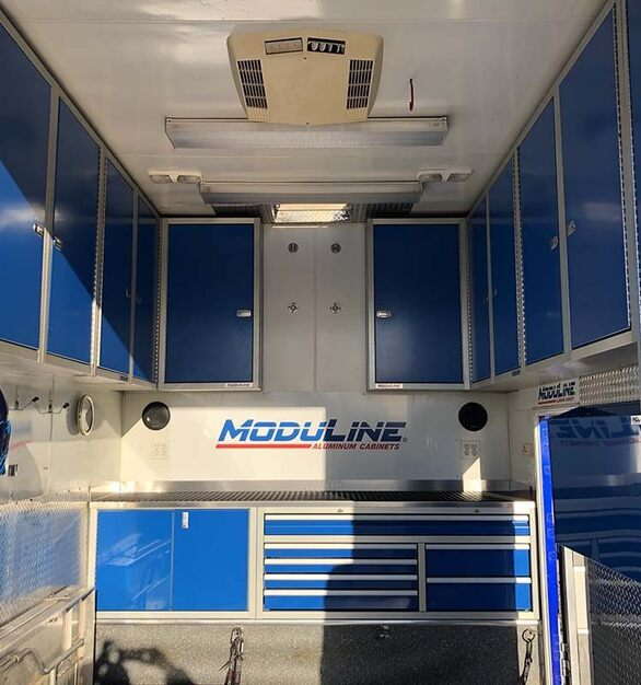 Moduline's lightweight aluminum cabinets in a Four Winds Fun Mover truck.  These custom cabinets are configured to fit any space.