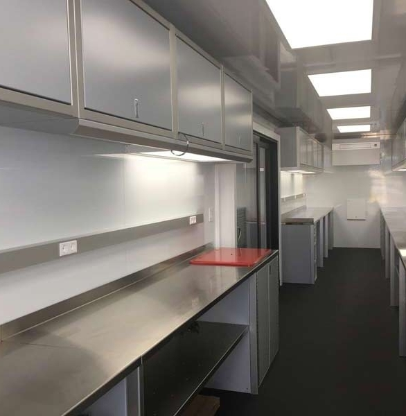 Bella Mente race support container with Moduline Aluminum Cabinets.  Custom create your own covered trailer for your business, racing, or any other reason.