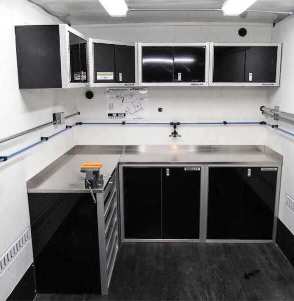 Moduline's ProII™ SERIES signature black aluminum cabinets in a truck.  These custom cabinets can fit in any space.