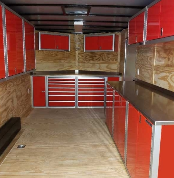 Moduline PROII™ red aluminum cabinets in a v-nose trailer, perfect for the traveling business owner that needs their tools with them.