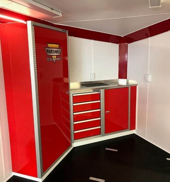 A v-nose trailer showcasing Moduline's PROII™ aluminum cabinets.  Moduline's custom cabinets  fit any space and need.