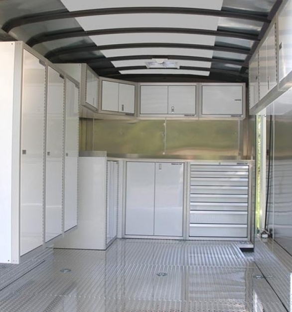 White Moduline PROII™ Lightweight Aluminum Cabinets seen here in a V-Nose trailer.  Perfect for those who do traveling racing.