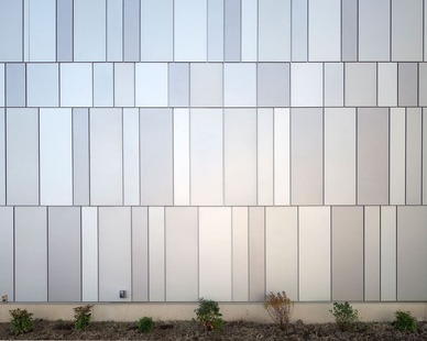 Dri-Design created multiple tones of grey to create a beautiful exterior for the Pittsburg State - Bicknell Center.  Here is a close up view of the Painted  Aluminum Panels.