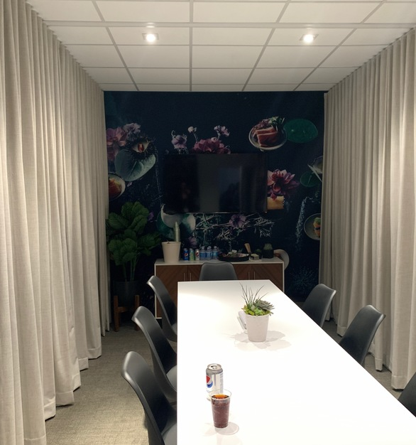 Seen here is American Drapery's Ripplefold Curtains for a pre-fab conference room.