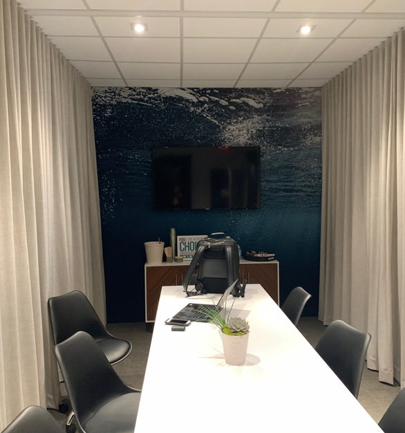 The Ripplefold drapery by American Drapery is the perfect addition to a pre-fab conference room.