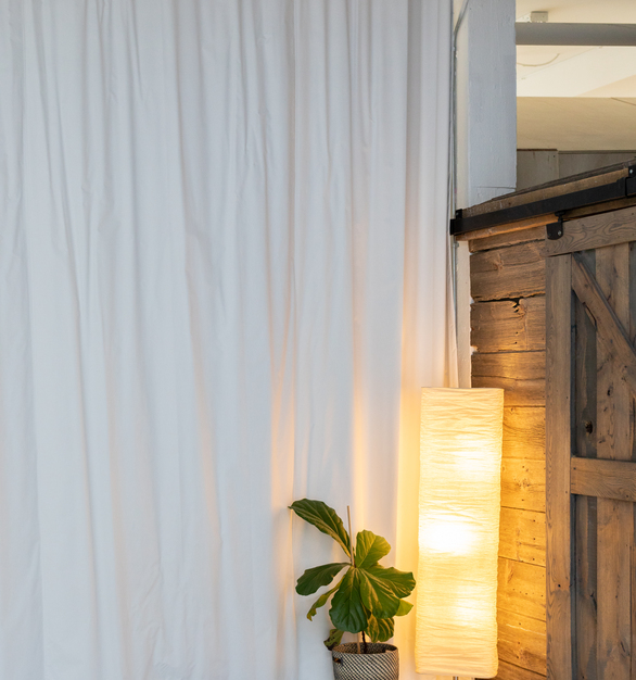 Blackoutcurtains.com provides the perfect amount of light control for this co-working space.   Photo credit:Quincy Street Kitchen