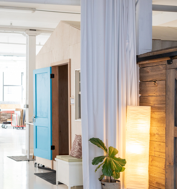 Beautiful finished space showcasing blackout curtains to provide light control for this creative co-working space.   Photo credit:Quincy Street Kitchen