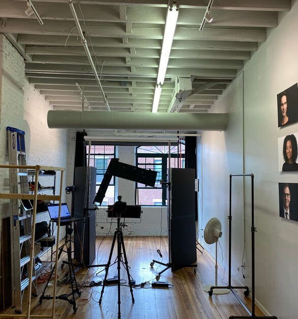 Charlie Abrahams Photography studio showcasing the blackout curtains in the back covering the windows in this space.