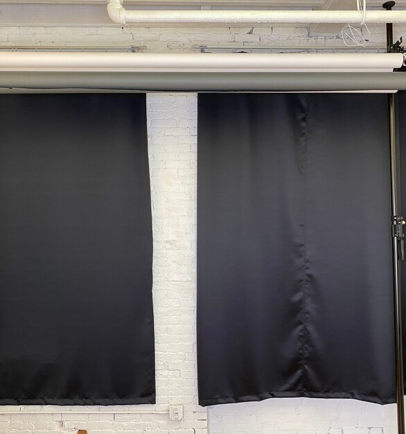 Seen here is American Track Supply and Blackoutcurtains.com products in use for a photography studio.