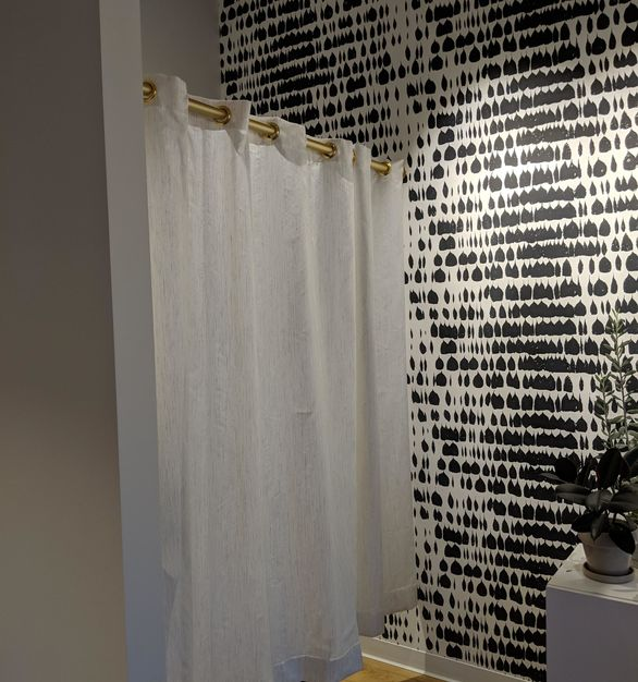 A fitting room, showcasing American Drapery's curtains within the CEO's private office.