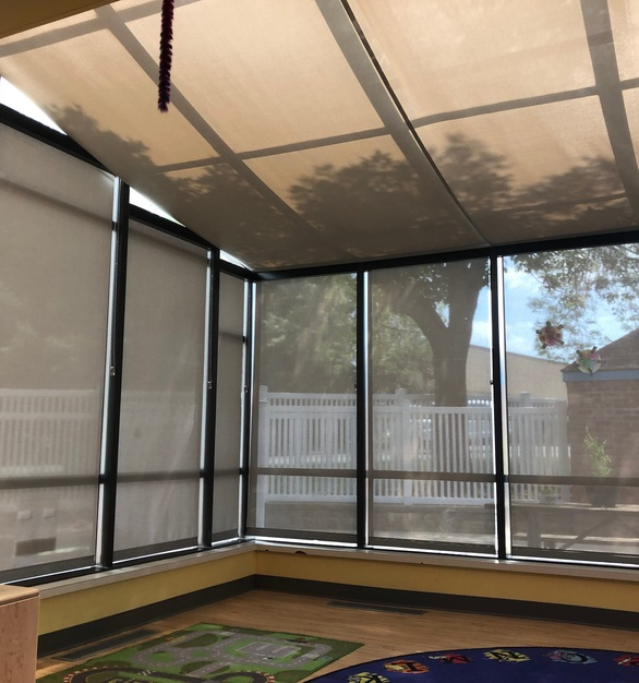 American Drapery products are not only on the window making up walls but also ones that make up the ceiling to this sunroom.